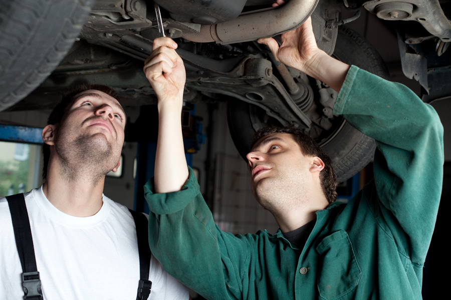 Car Mechanics repairing car